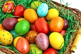 13169258-colorful-dyed-easter-eggs-placed-in-a-wooden-basket
