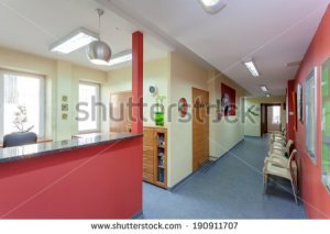 stock-photo-waiting-room-with-reception-in-medical-clinic-190911707