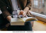 stock-photo-young-man-reading-a-book-244451953